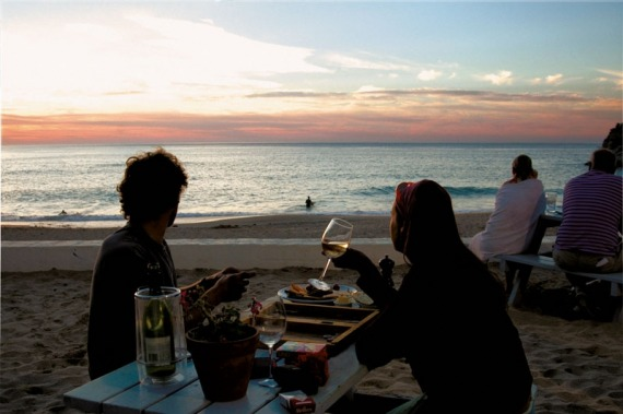 Image of people drinking wine on beach